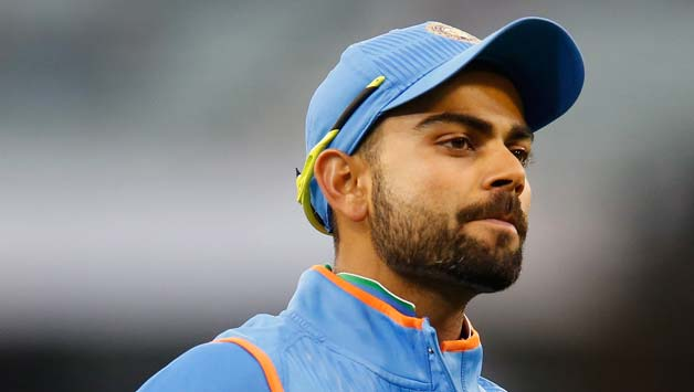 Virat-Kohli-of-India-points-to-the-India-logo-on-his-clothing-as-he-gestures-to-fans-31